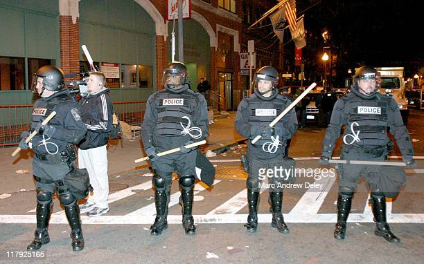 A row of police officers in riot gear wait outside the gate into Fenway Park after the Red Sox clinched the ALCS on Wednesday October 20 2004 Riots...