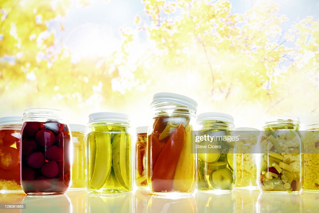 Row of preserved, jarred vegetables : Stock Photo