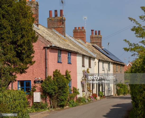 Row of pretty historic cottages, East Lane, Bawdsey, Suffolk, England, UK.