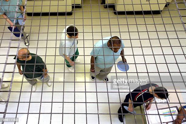 A row of prisoners wait to collect food in C wing at Wandsworth Prison in London UK on Friday May 4 2007 It doesn't take Sean much time to show...