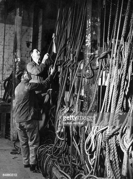 Row of pulley ropes backstage at the Theatre Royal in Bristol, later the Bristol Old Vic, circa 1940.