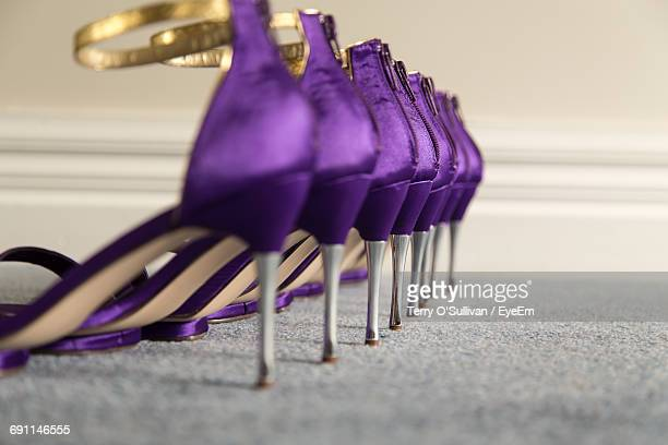 Row Of Purple High Heels On Carpet