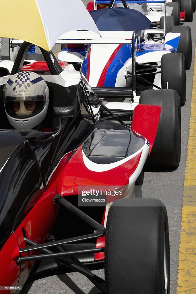 Row of racecars on a motor racing track : Foto de stock