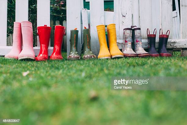 row of rain boots - multi colored shoe stock pictures, royalty-free photos & images