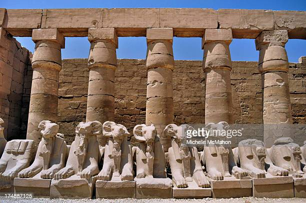 CONTENT] A row of Ram headed Sphinx statues and columns at the Temple of Karnak in Luxor Egypt It is a vast city of temples which was built over 2000...