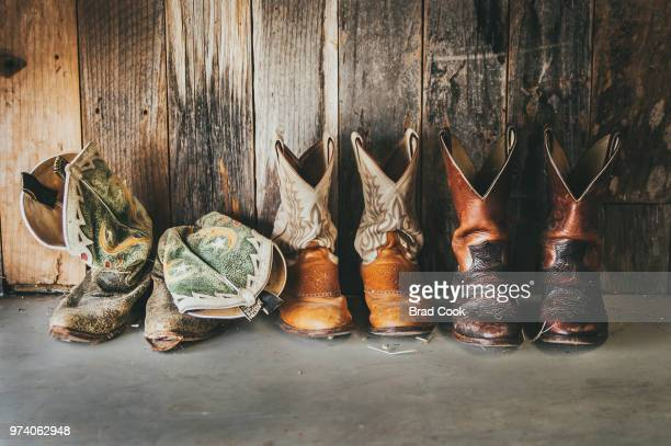 row of rasty cowboy boots - leather boot stock pictures, royalty-free photos & images