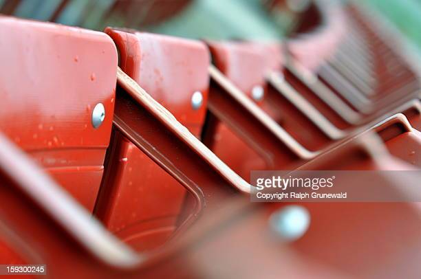 a row of red chairs - jay pritzker pavillion stock photos and pictures