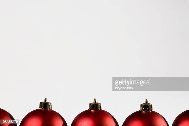 row of red christmas baubles