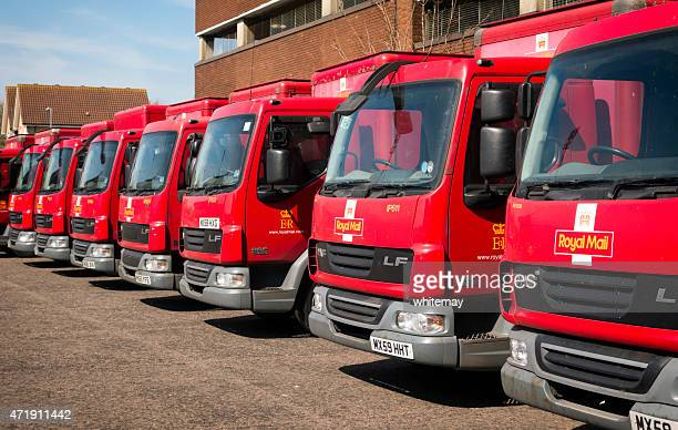 Row of red Royal Mail vans