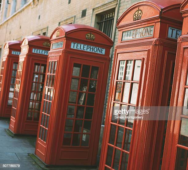 CONTENT] Row of red telephone booths design by Sir Giles Gilbert Scott near Covent Garden London England United Kingdom Europe