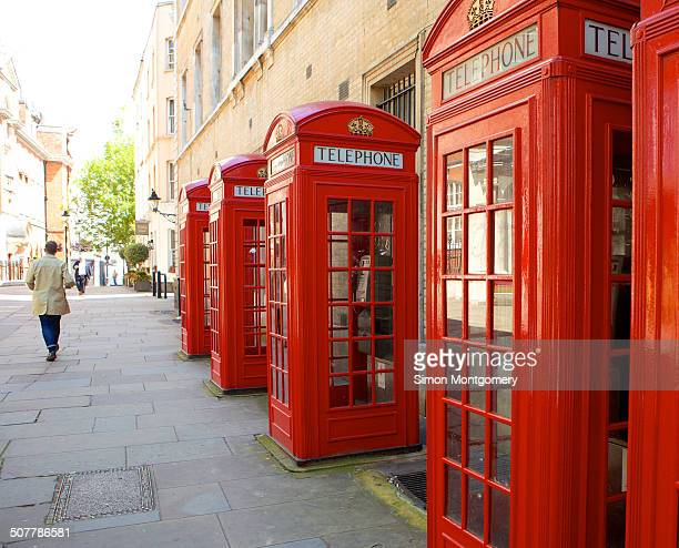 Row of red telephone booths in London