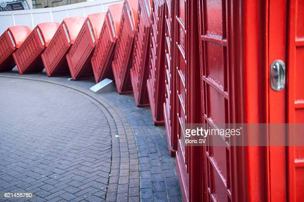 Row of red telephone boxes, Kingston upon Thames, England.