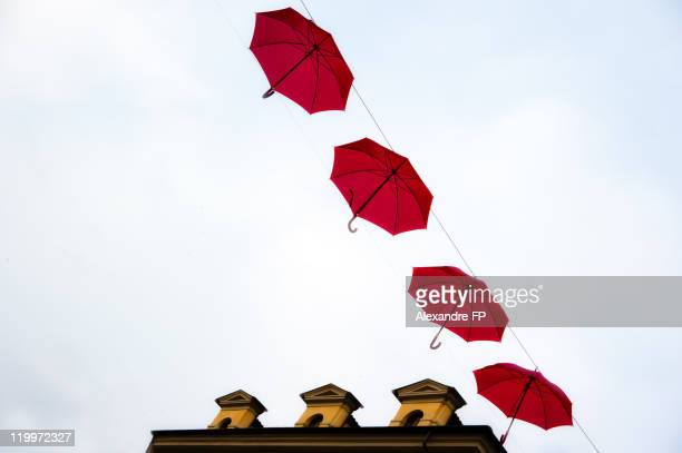 Row of red umbrellas suspended in air