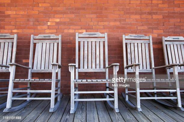 row of rocking chairs - rocking chair stock pictures, royalty-free photos & images