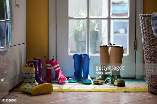 Row of rubber boots at back door