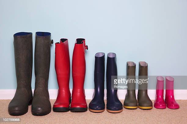 row of rubber boots - rubber boot stock pictures, royalty-free photos & images