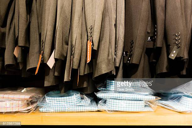 Row of sale suit jackets in men's clothes shop