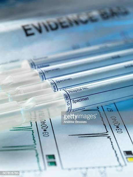 A row of samples from a crime scene on top of genetic testing results