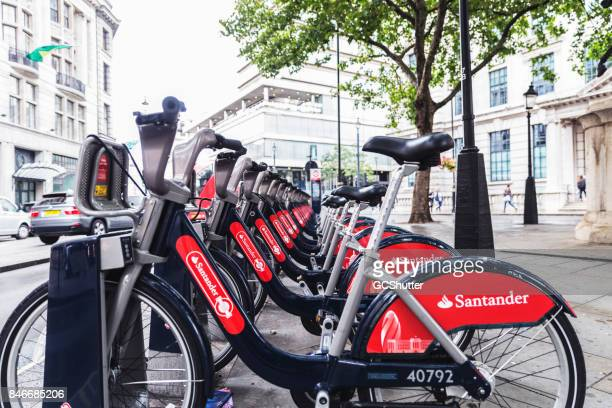 Row of Santander issued bike rentals at their dock awaiting the next commuter