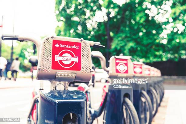 Row of Santander sponsored bike rentals at their dock awaiting the next commuter