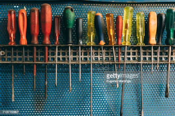 row of screwdrivers in forge workshop - screwdriver stock pictures, royalty-free photos & images