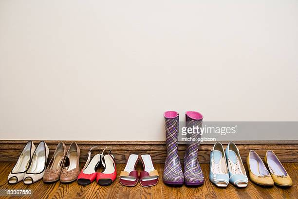 A row of shoes from heels to rain boots