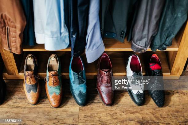 a row of shoes on display - men fashion stock pictures, royalty-free photos & images