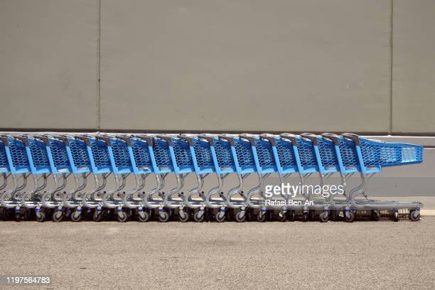 row of shopping trolleys carts outside supermarket - rafael ben ari stock pictures, royalty-free photos & images