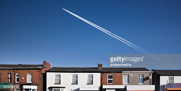 row of shops with airplane-click for related images - carbon dioxide stock photos and pictures