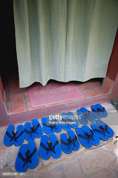 Row of slippers at doorway entrance