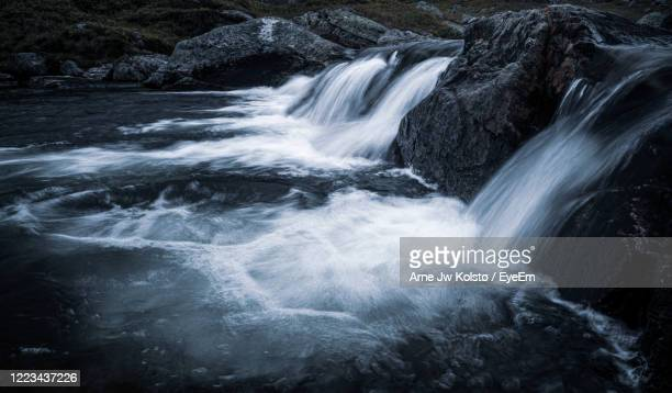 row of small waterfalls in a nordic highland landscape. - arne jw kolstø stock pictures, royalty-free photos & images