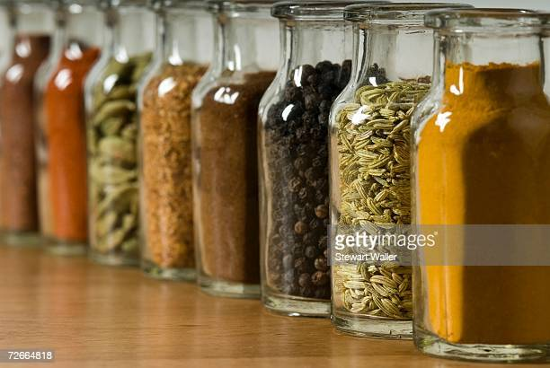 row of spice jars - spice stock pictures, royalty-free photos & images