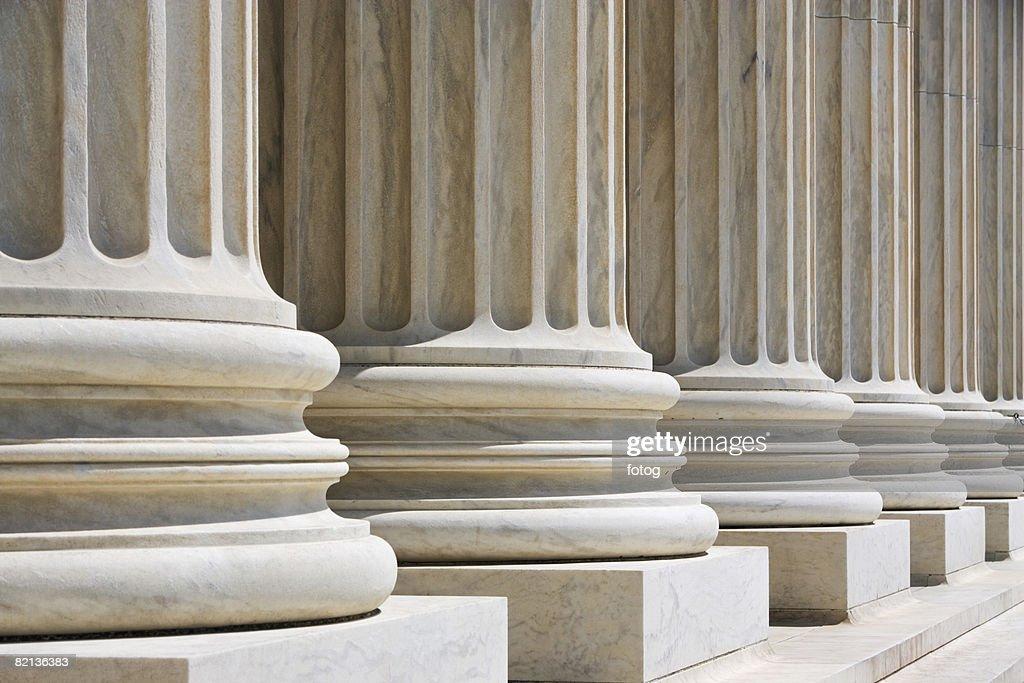 Row of stone columns : Stock Photo