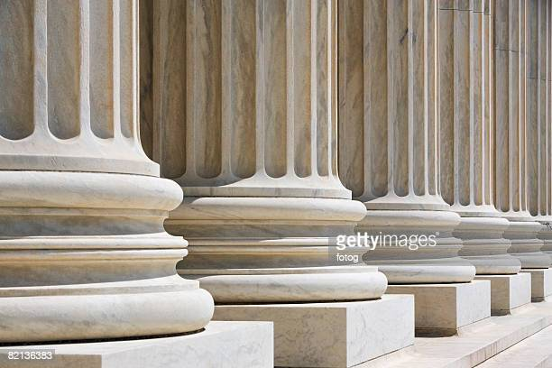row of stone columns - column stock pictures, royalty-free photos & images
