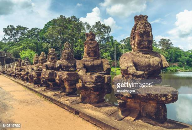 row of stone statues ruins in Bayon temple,angkor thom,cambodia