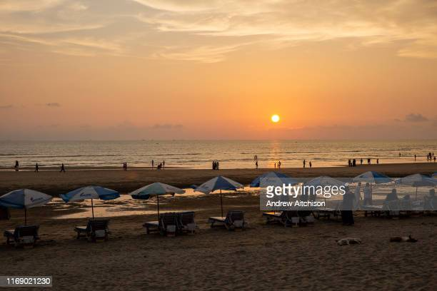A row of sunlounger beds and umbrellas at sunset on Laboni Beach looking out to the Bay of Bengal near in Cox Bazar Chittagong Division Bangladesh...