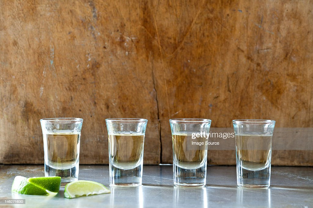 Row of tequila shots : Stock Photo