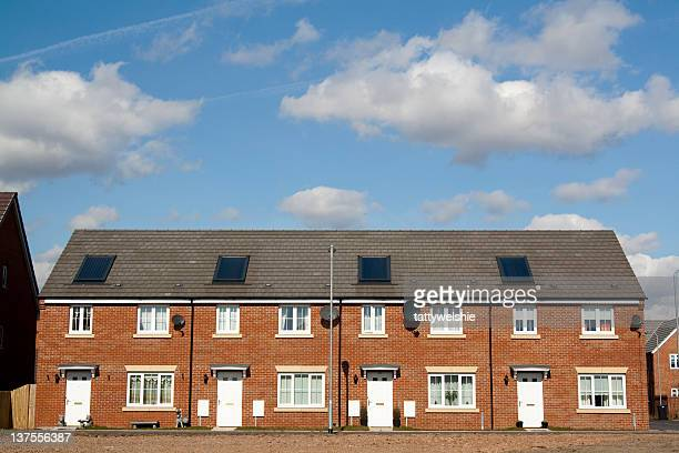 row of terraced houses with white doors - terraced_house stock pictures, royalty-free photos & images