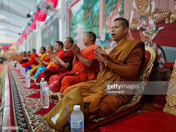row of thai buddhist monks chanting during a buddhist ceremony. - chanting stock pictures, royalty-free photos & images