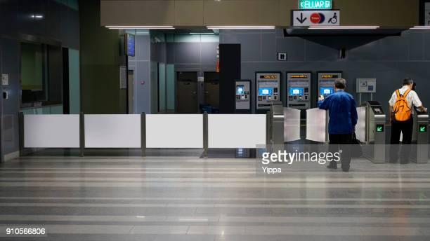Row of ticket machines gates in Kuala Lumpur MRT railway station, Malaysia