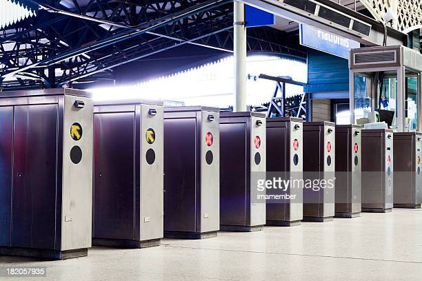 Row of ticket machines in railway station, copy space