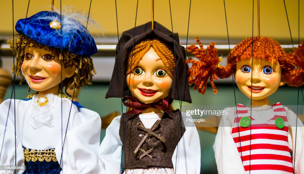 Row of traditional puppets : Stock Photo