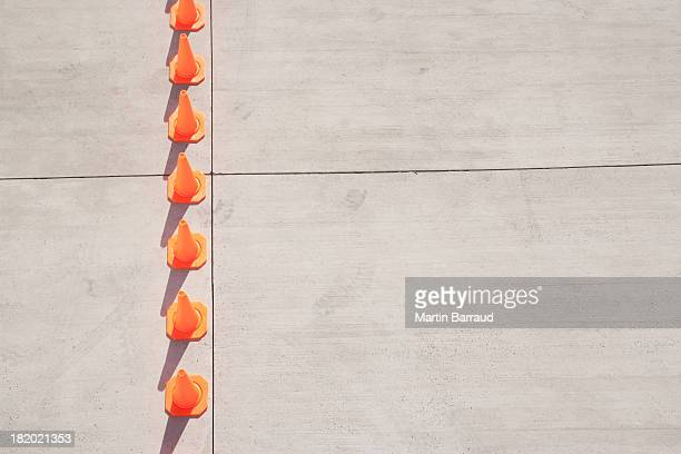 row of traffic cones - traffic cone stock pictures, royalty-free photos & images
