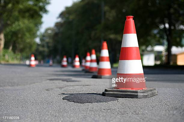 row of traffic cones - selective focus - traffic cone stock pictures, royalty-free photos & images