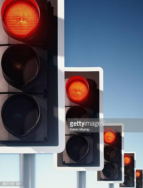 Row of traffic lights, red lights illuminated (Digital Composite)