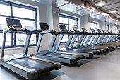 Row of treadmills in a gym