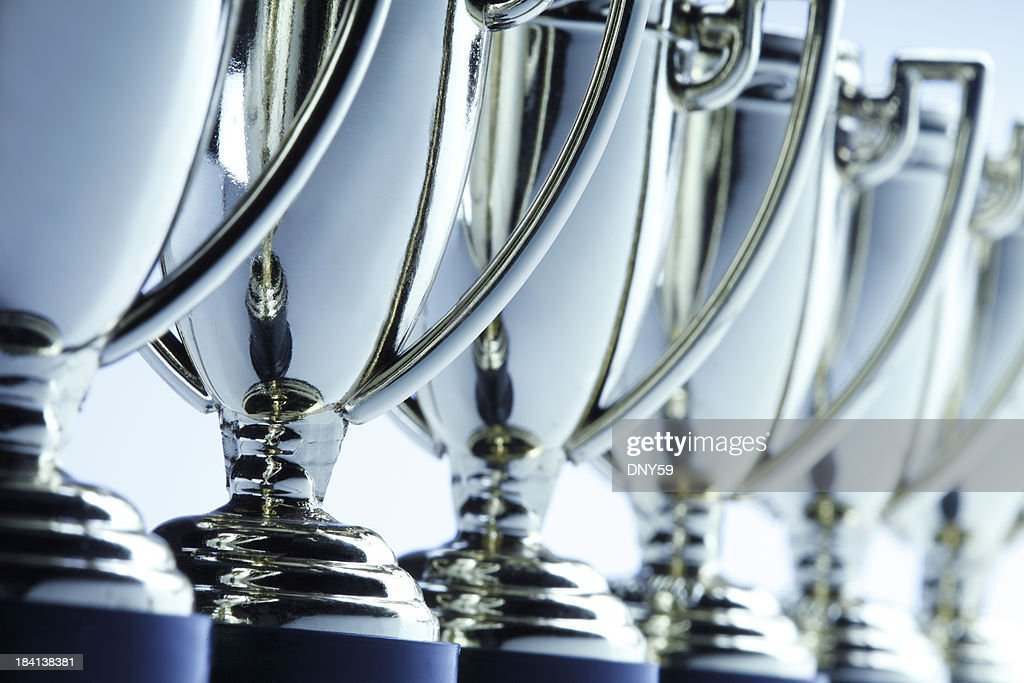 Row of trophies : Stock Photo