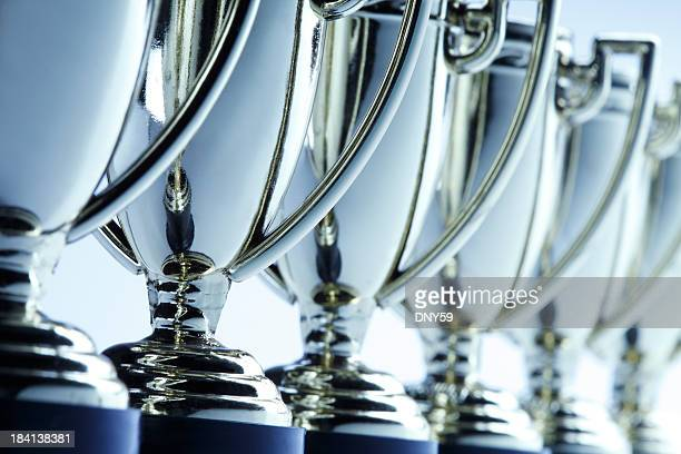 row of trophies - award stock pictures, royalty-free photos & images