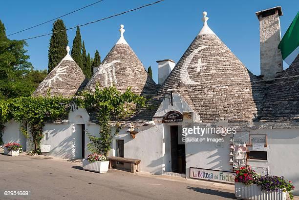Row of Trullo Houses in Monte Pertica Street Alberobello Trulli Puglia Italy