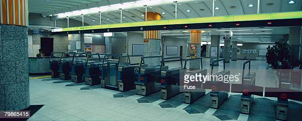 Row of Turnstiles in a Subway Station